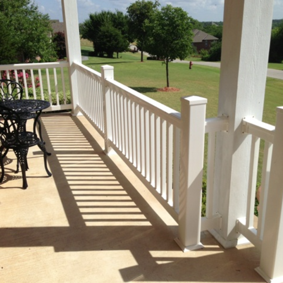 Midland vinyl fence   deck company   tulsa and coweta  oklahoma   vinyl metal wood fence sales and installation   outdoor living  railing   white vinyl railing on covered front porch  looking out20170611 18629 e7edb4