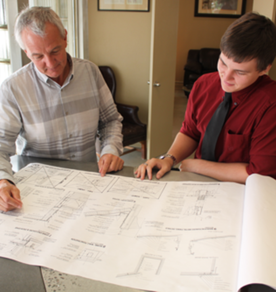 Barron and mcclary gc   tulsa  oklahoma   general contractors   about us   kurt and grant looking at plans20170727 2497 ndbw2g