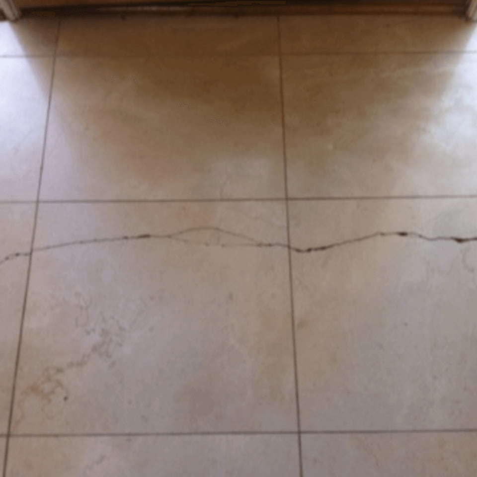 Crack in tile floor dallas min