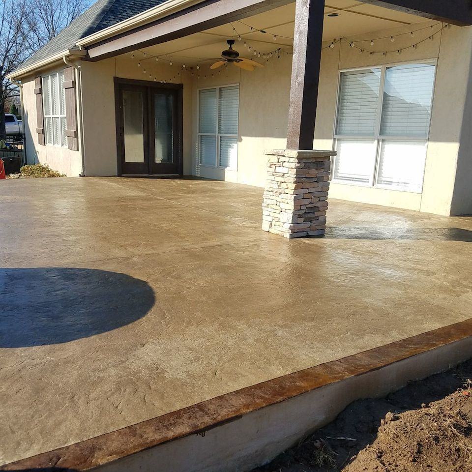 Engineered concrete systems   tulsa oklahoma   textures and finishes   two tone stained and textured concrete patio with patterned sawcutting in residential backyard outdoor living space after photo 20171215 20180108 27141 10jjinl