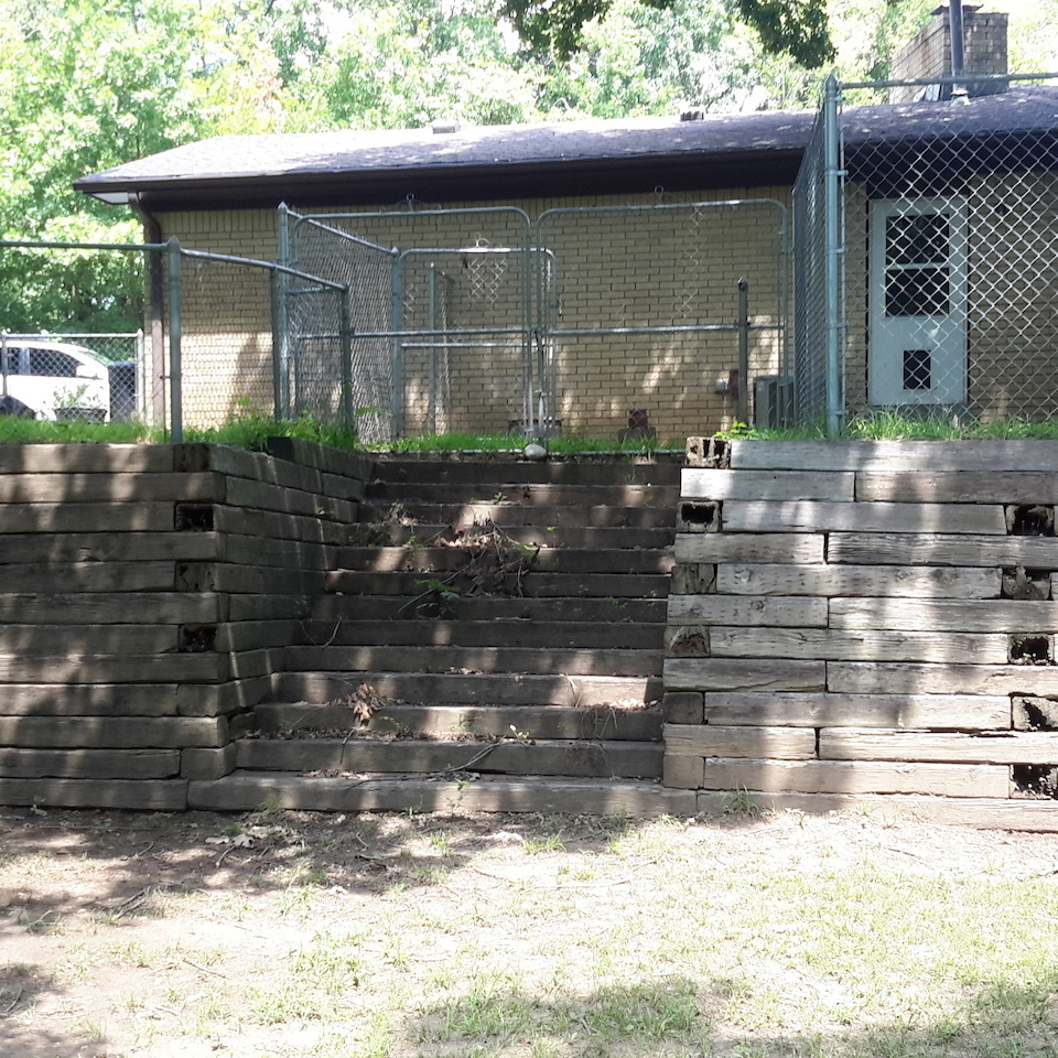 Engineered concrete systems   tulsa oklahoma   retaining walls   replacement concrete retaining wall for residential side yard before photo of old wooden railroad tie wall 20170717 11440720180108 1236 1crxn99