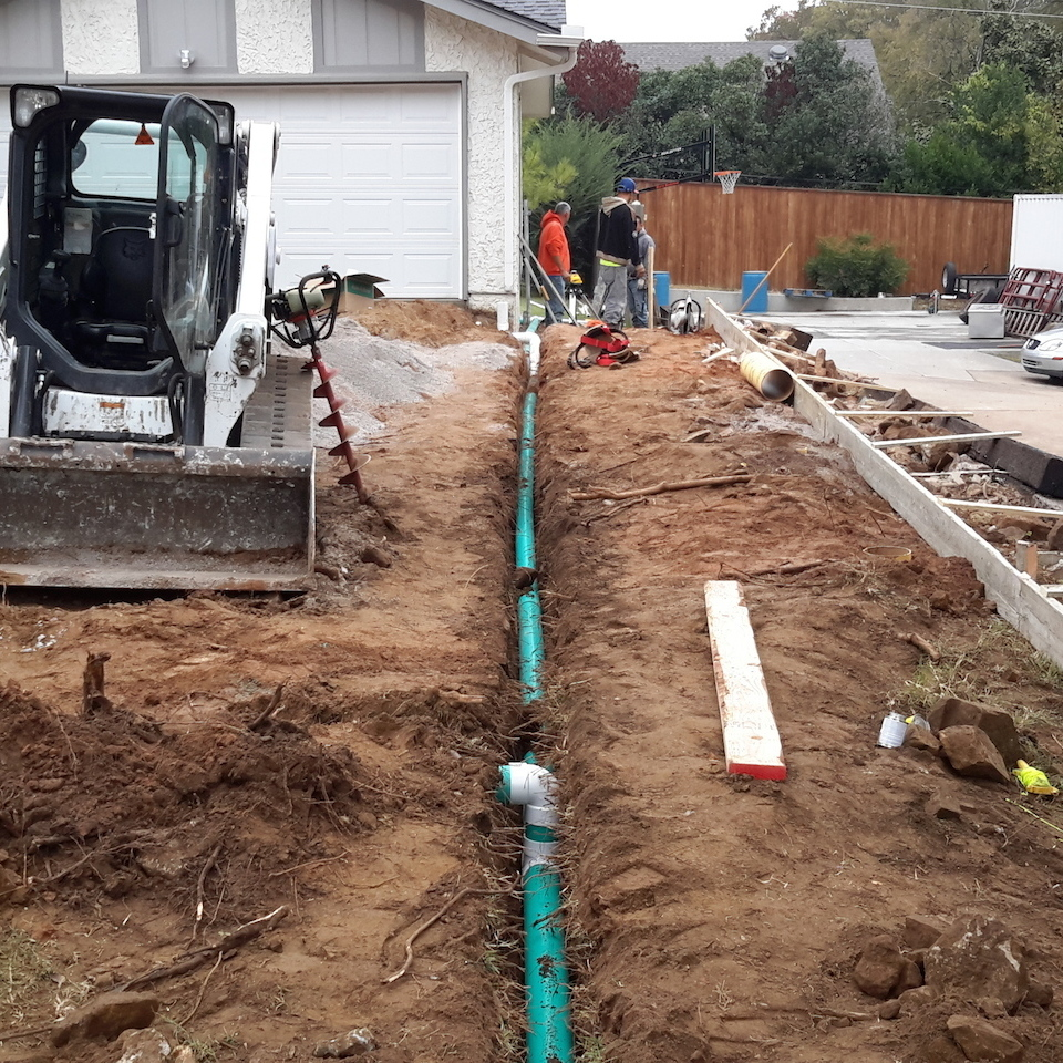 Engineered concrete systems   tulsa oklahoma   engineered driveways   residential driveway replacement during photo of gutter runoff drain installation under new driveway 20171103 14304220180108 1241 au0kpk