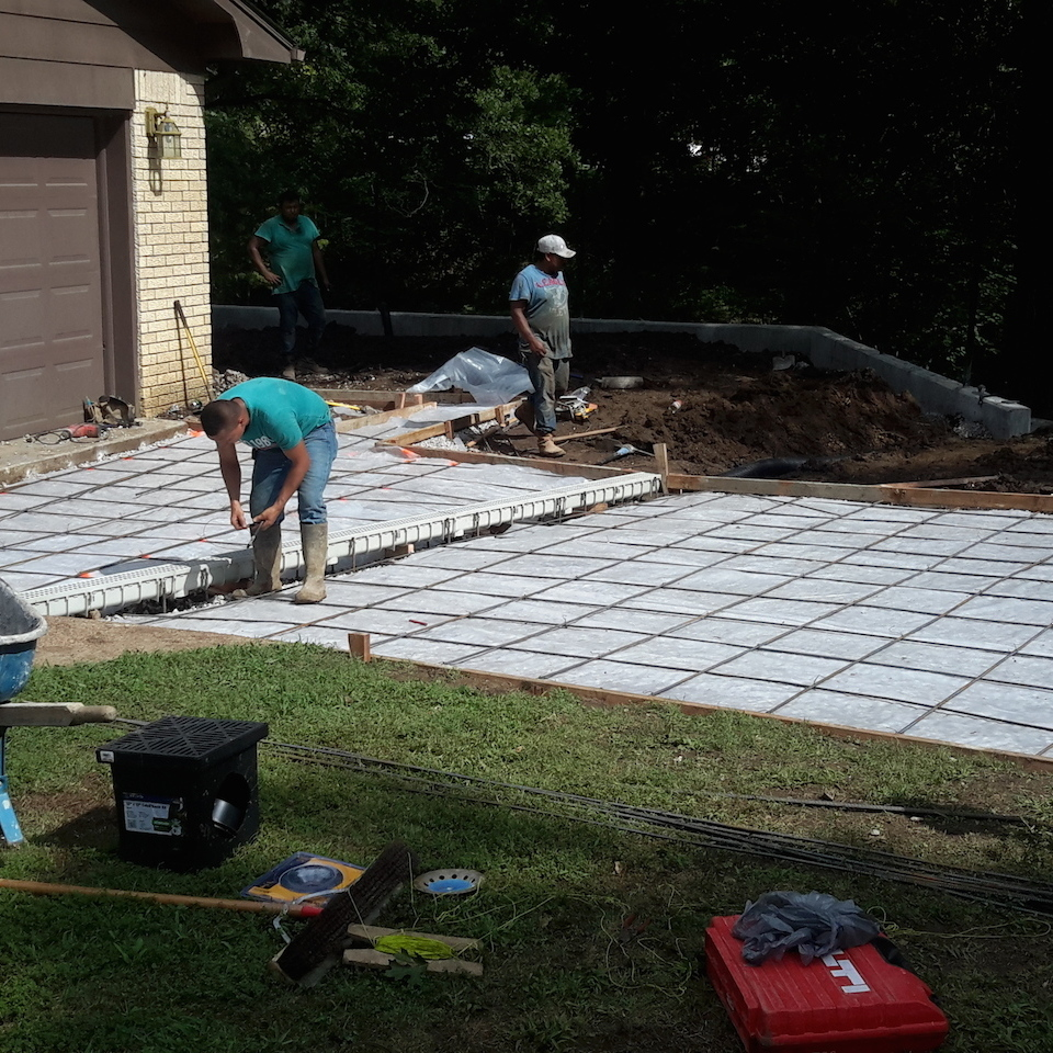 Engineered concrete systems   tulsa oklahoma   engineered driveways   residential driveway replacement during job photo installation of french drain built into new driveway 20170816 16070820180108 2859 de2xvr