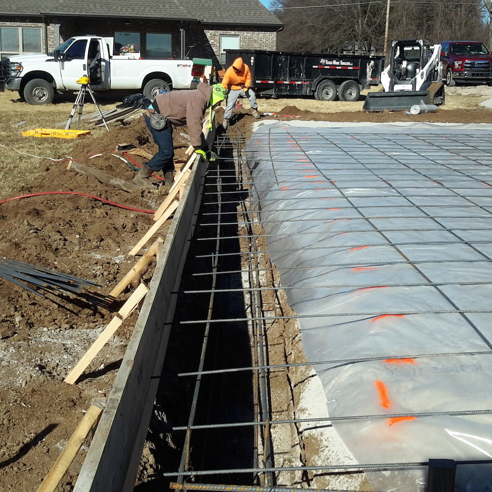 Engineered concrete systems   tulsa oklahoma   engineered footings and slabs   before photo of new concrete slab installation with concrete footings rebar moisture barrier gravel bed and forms in place 20171207 13223320180108 3714 ggv1d9
