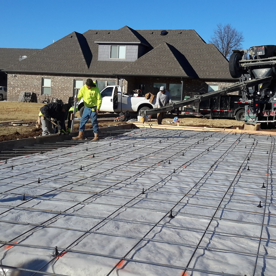 Engineered concrete systems   tulsa oklahoma   engineered footings and slabs   during photo of new concrete slab installation with concrete footings finishing and checking the concrete footings 20171207 14383720180108 1236 hpy8a5