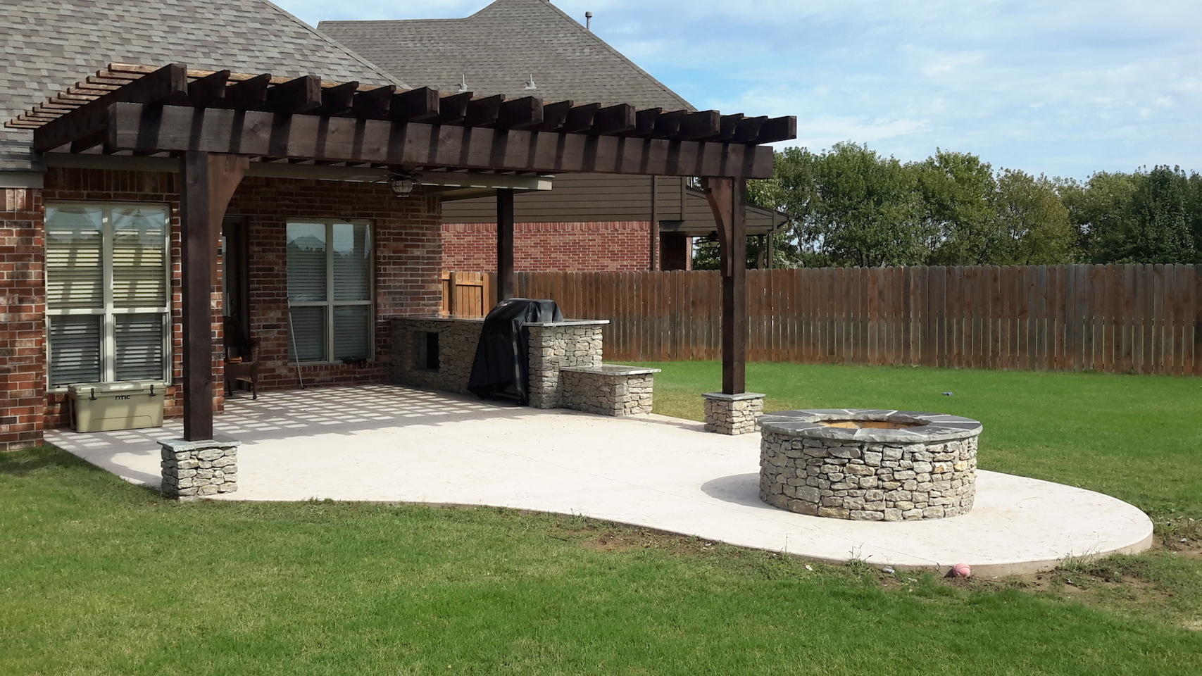 After Photo Of Professionally Designed And Installed Custom Wooden Pergola Concrete Patio With Fire Pit Outdoor Kitchen Near Tulsa