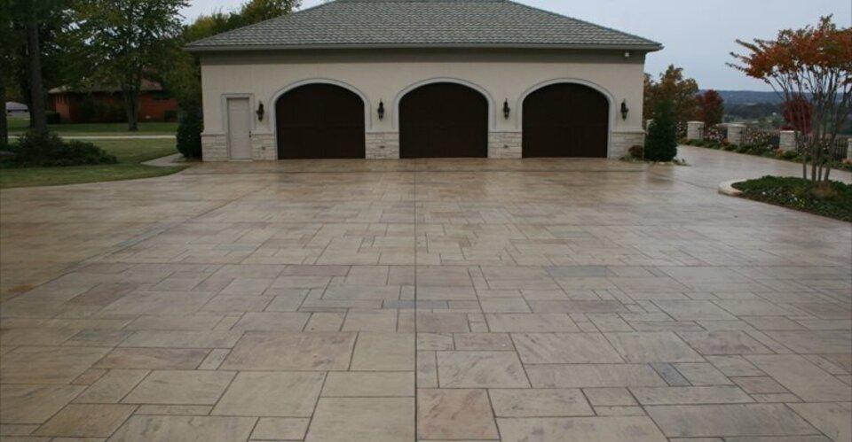 Garage parking stamped stone ozark pattern concrete inc 55821