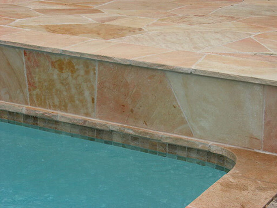 Peach flagstone pool coping with snapped edges