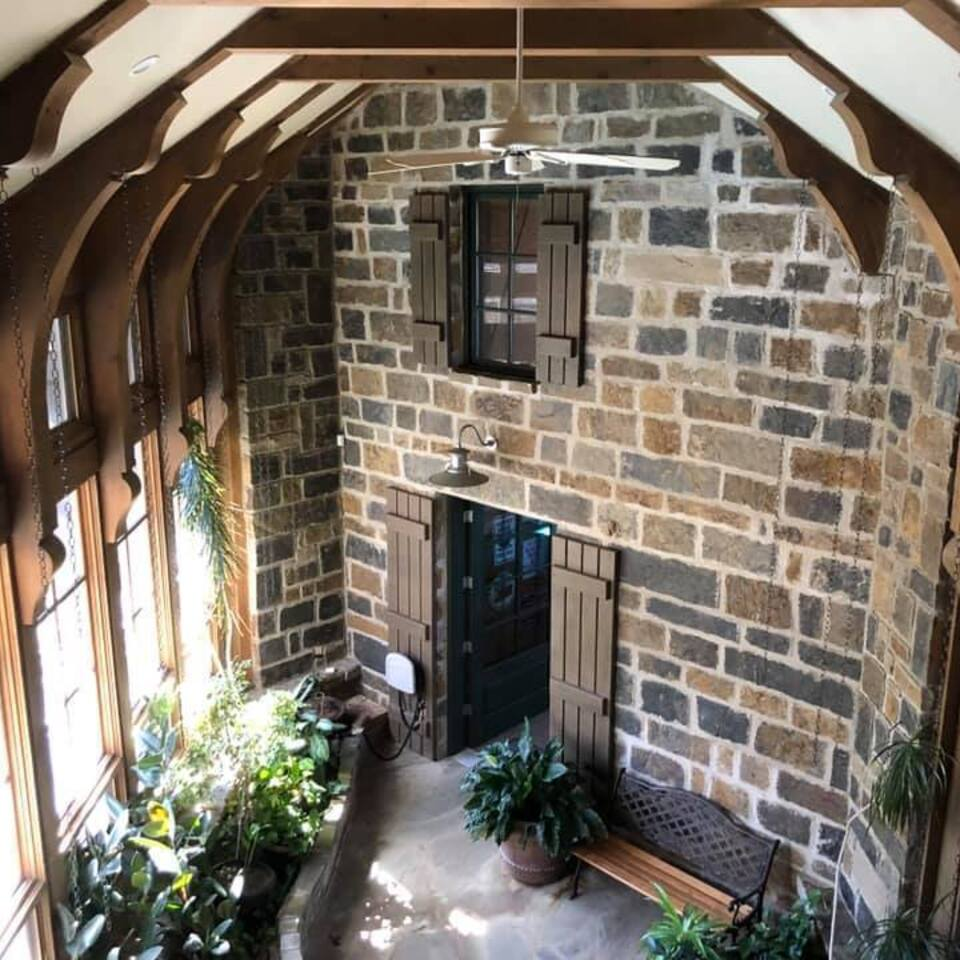 3d solutions general contractors   tulsa oklahoma   country style stone wall wood beam vaulted enclosed connecting walkway build