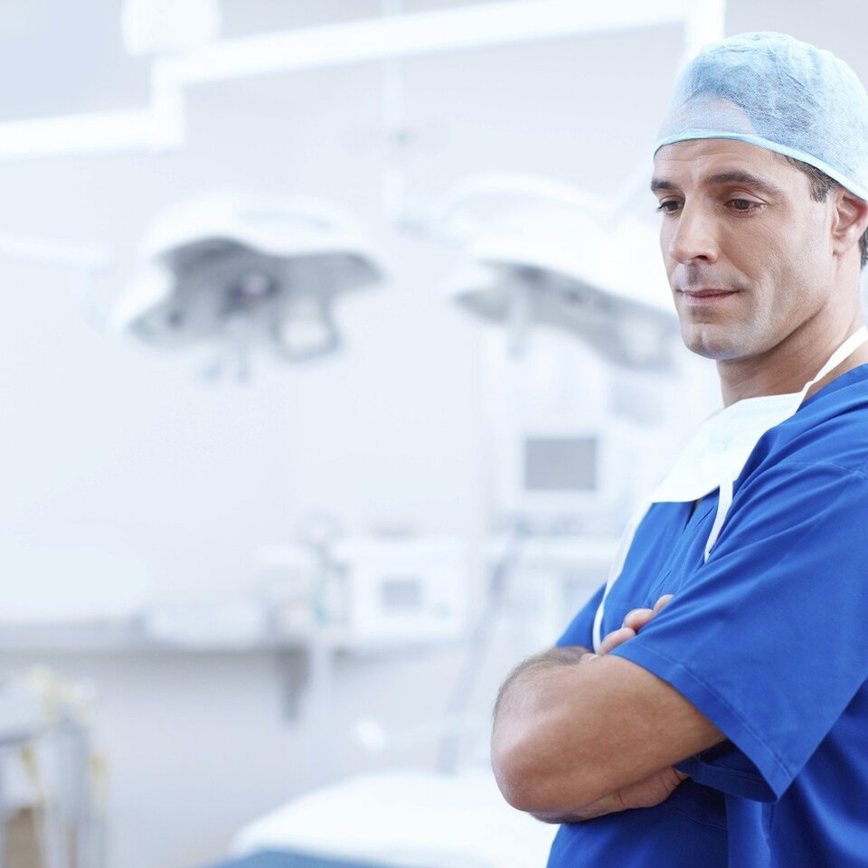 Caucasian Male Dentist in Blue Scrubs