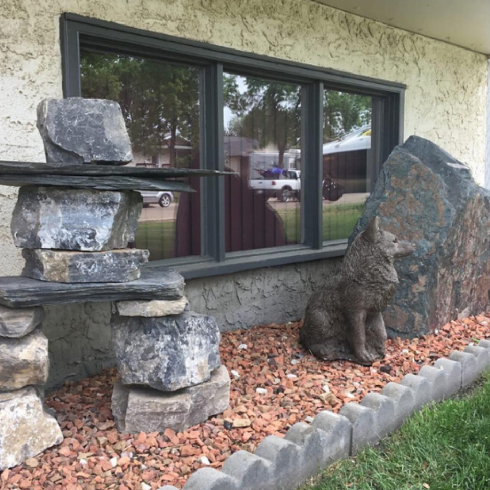 Boulder landscaping inuksuk window