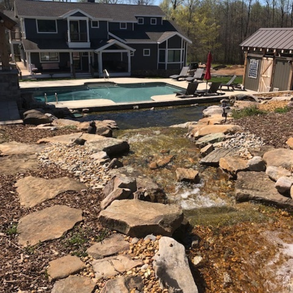 Bevill ext outdoor pic with koi pond and house2