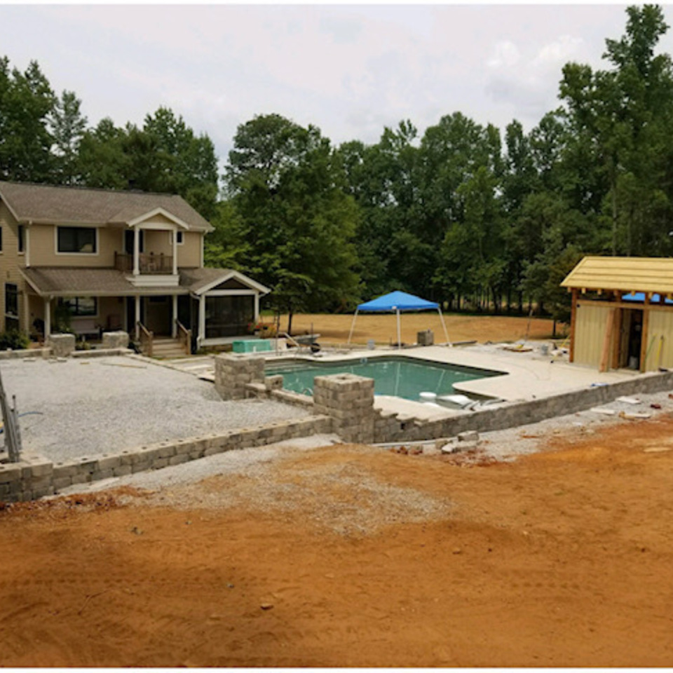 Bevill ext before pool in and pool house in construction
