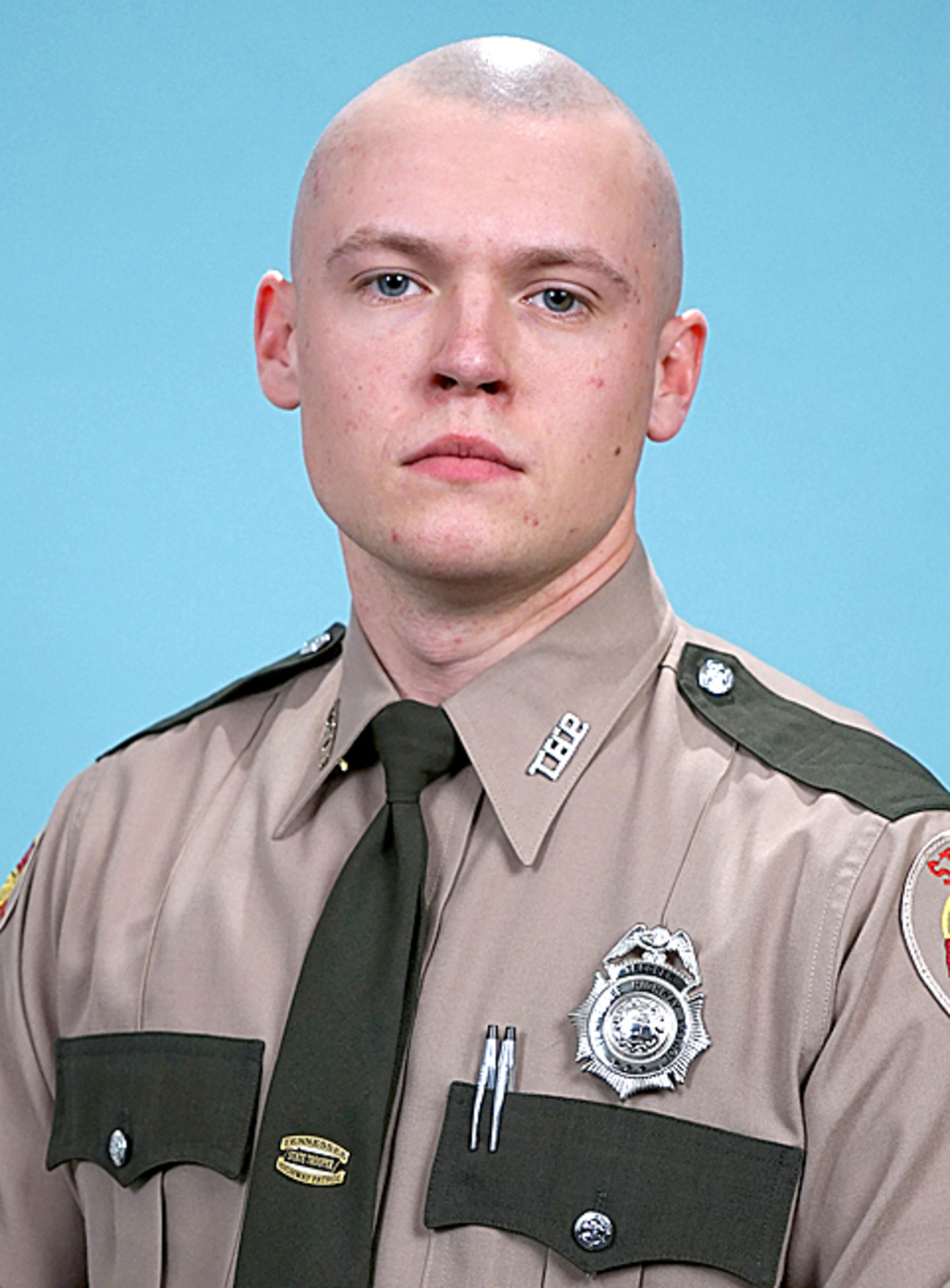 Matthew Russell earns Tennessee Highway Patrol badge